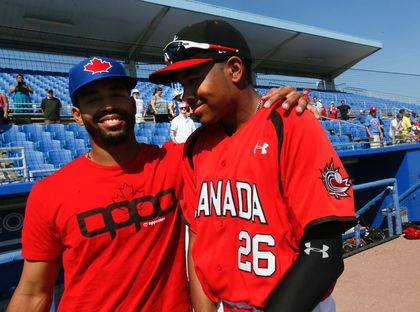 Dalton Pompey, left, with his little-'big' brother Tristan  at Dunedin before thee Canadian Junior National Team played the Toronto Blue Jays.