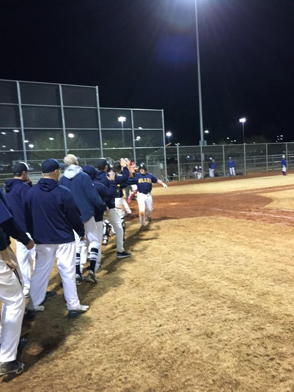 The Langley Blaze form a line to greet Rhys Cratty after a game-winning hit against the Minnesota Blizzard at a Las Vegas tournament.