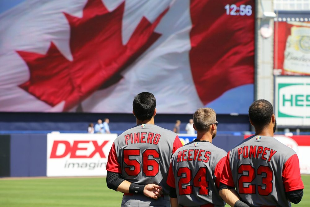 SS Daniel Pinero (Toronto, Ont.), C Mike Reeves (Peterborough, Ont.) and CF Dalton Pompey (Mississauga, Ont.) at attention during anthem.