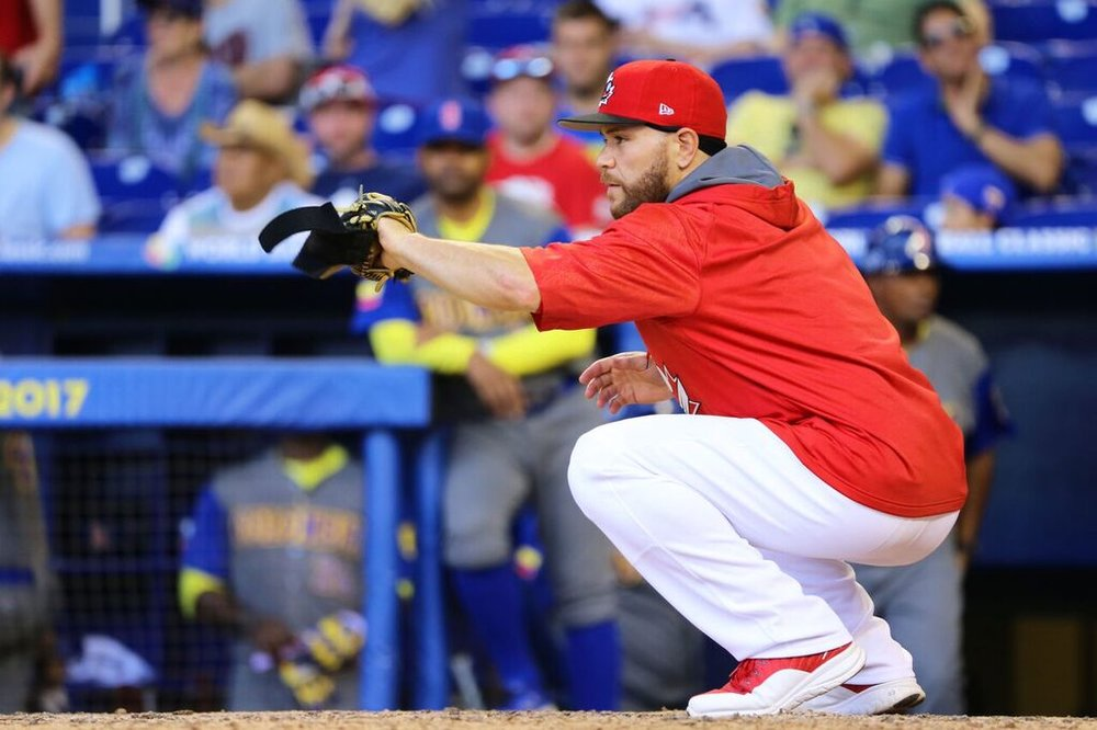 Russell Martin (Montreal, Que.) warms up a pitcher between innings in Saturday's loss to Colombia. Photos: Amanada Fewer.