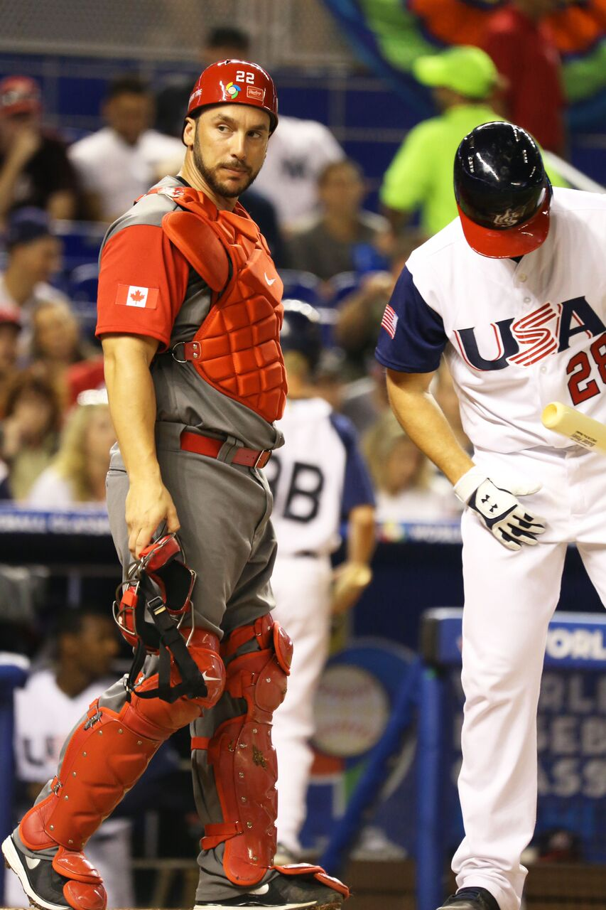C George Kottaras (Markham, Ont.) looks into the Canadian dugout as if he is looking for suggestions on how to get out Team USA hitters. Photos: Amanada Fewer.