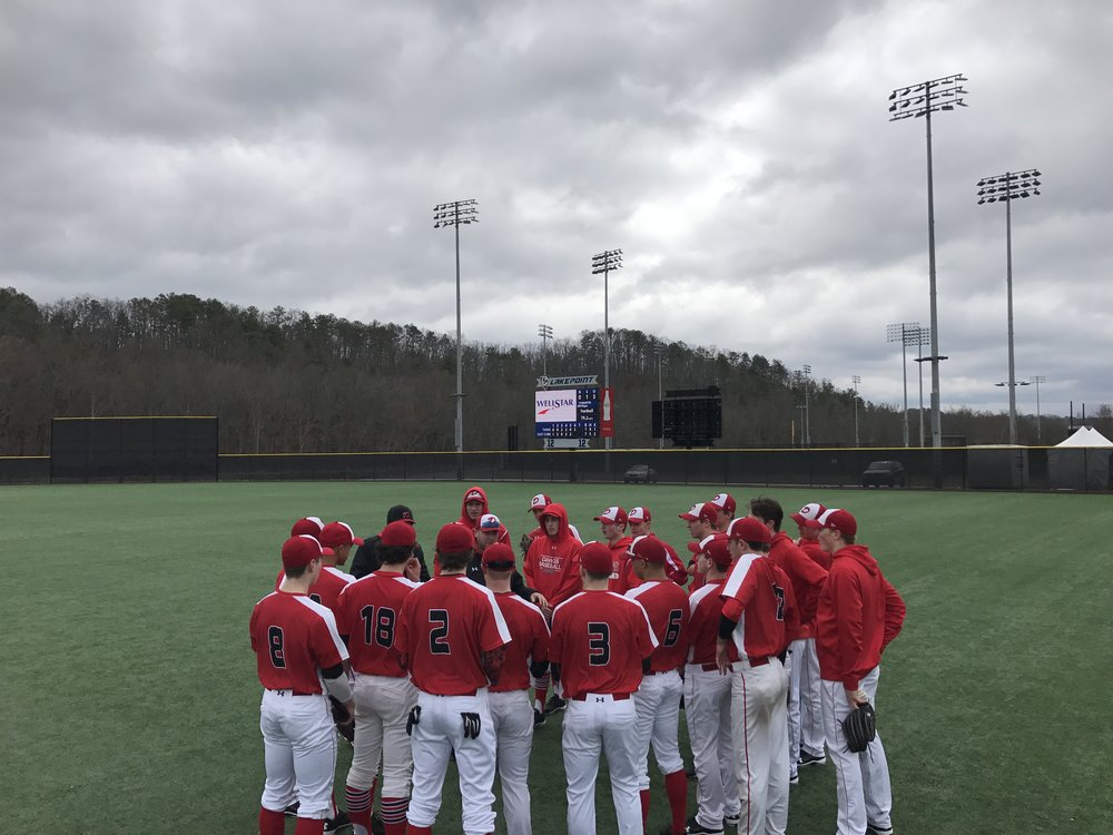 The Okotoks Dawgs gather before a Perfect Game High School Showdown-Academies game Cartersville, Ga.