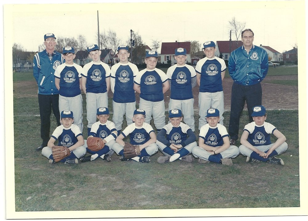 The Toronto peewee champion Queensway Lions with coaches Jim Price (glasses, back row left) and Bob Sanders (right). That's White in the front row, the cute one, second from the right.