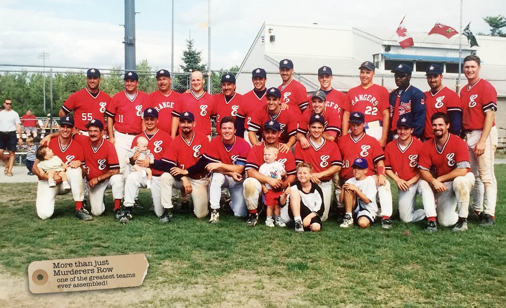The 1999 Ontario champion Etobicoke Rangers. Back row (left to right): Denny Berni, Jon Kielb, Whitey Breitner, Rick Malinowski, Curt Duggan, Dane Clatney, Jonathan Cardella, Chris Rogers, Rob Pineau, Shawn Hill, Kevin Breitner, Troy Hamilton, Steve Sidoriak and Greg O'Halloran. Bottom row: Joe Jurus with Eilidh, Len Gauthier, Roman Kula with Ryan, Manny DeMelo, Warren Sawkiw, Dave Smilsky, with Nathan and Lucas, Bobby McGee, Kenny Forshee, Kyle Breitner, Frankie MacIntyre and Mike Gauthier. Missing: Andy Tulshi.