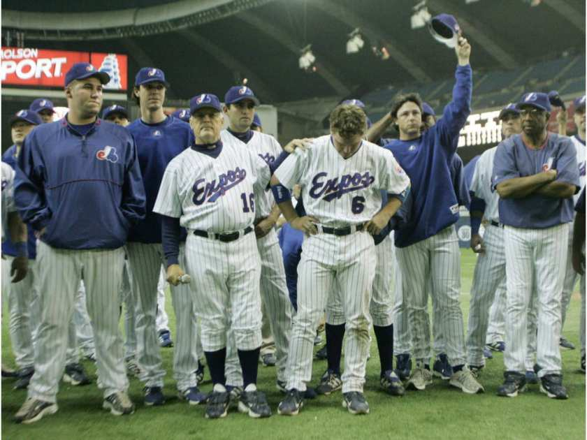 Former Montreal Expos reliever and coach Claude Raymond (16) and Brad Wilkerson stand front and centre saying goodbye to fans at the final home in 2004. Sept. 29, 2004. Photo: Carpenter/Montreal Gazette.