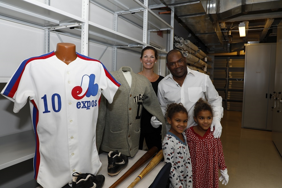 Tim Raines with his wife Shannon Raines and their twin daughters Ava and Amelie. They are standing alongside Andre Dawson's No. 10 and Ty Cobb's sweater with the Detroit Tigers.