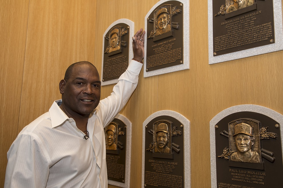 Tim  Raines stops by the plaque of the teammate of the late Gary Carter.