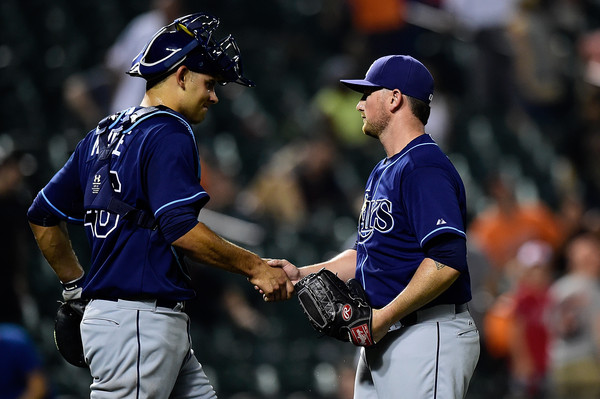 Luke Maile shakes hands with Kirby Yates after the Tampa Bay Rays defeated Baltimore Orioles 11-2 at Oriole Park at Camden Yards in Baltimore. Photo: Patrick McDermott/Getty Images North America.