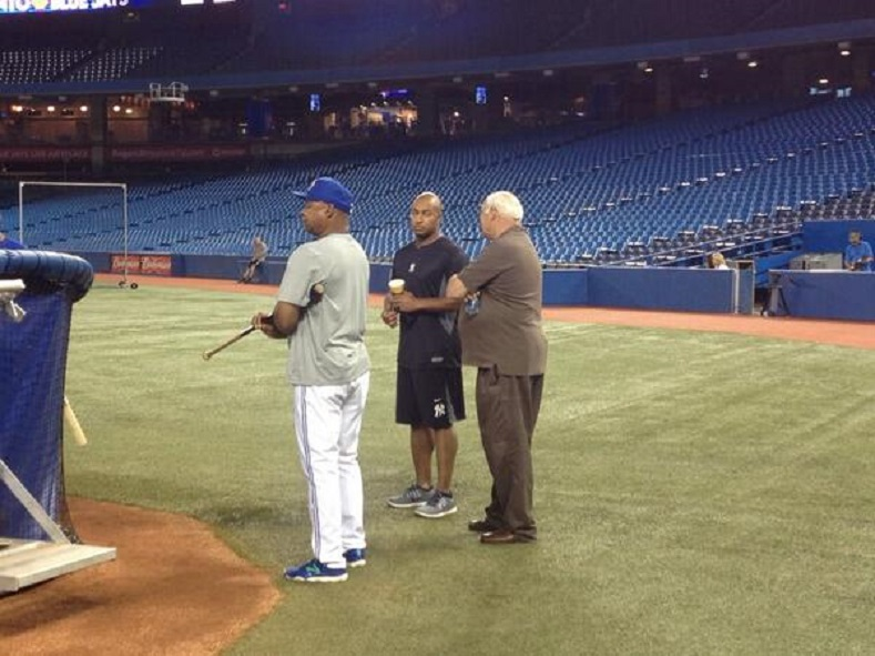 Ron Sandelli:, in suit, talks with ex-Blue Jays and former New York Yankee Vernon Wells as Blue Jays first base coach Dwayne Murphy stand nenaby watching batting practice. Photo: Toronto Star.