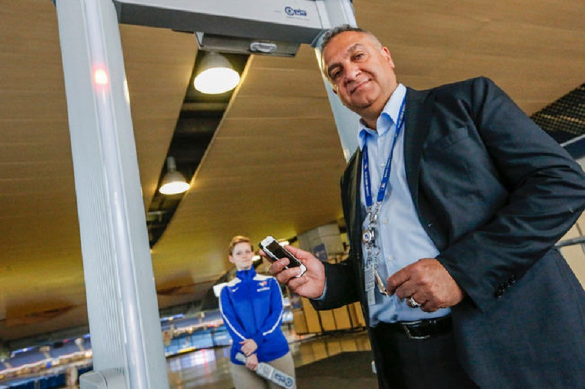 Mario Coutinho with one of 55 metal detectors installed in 2015. Photo: Toronto Sun.