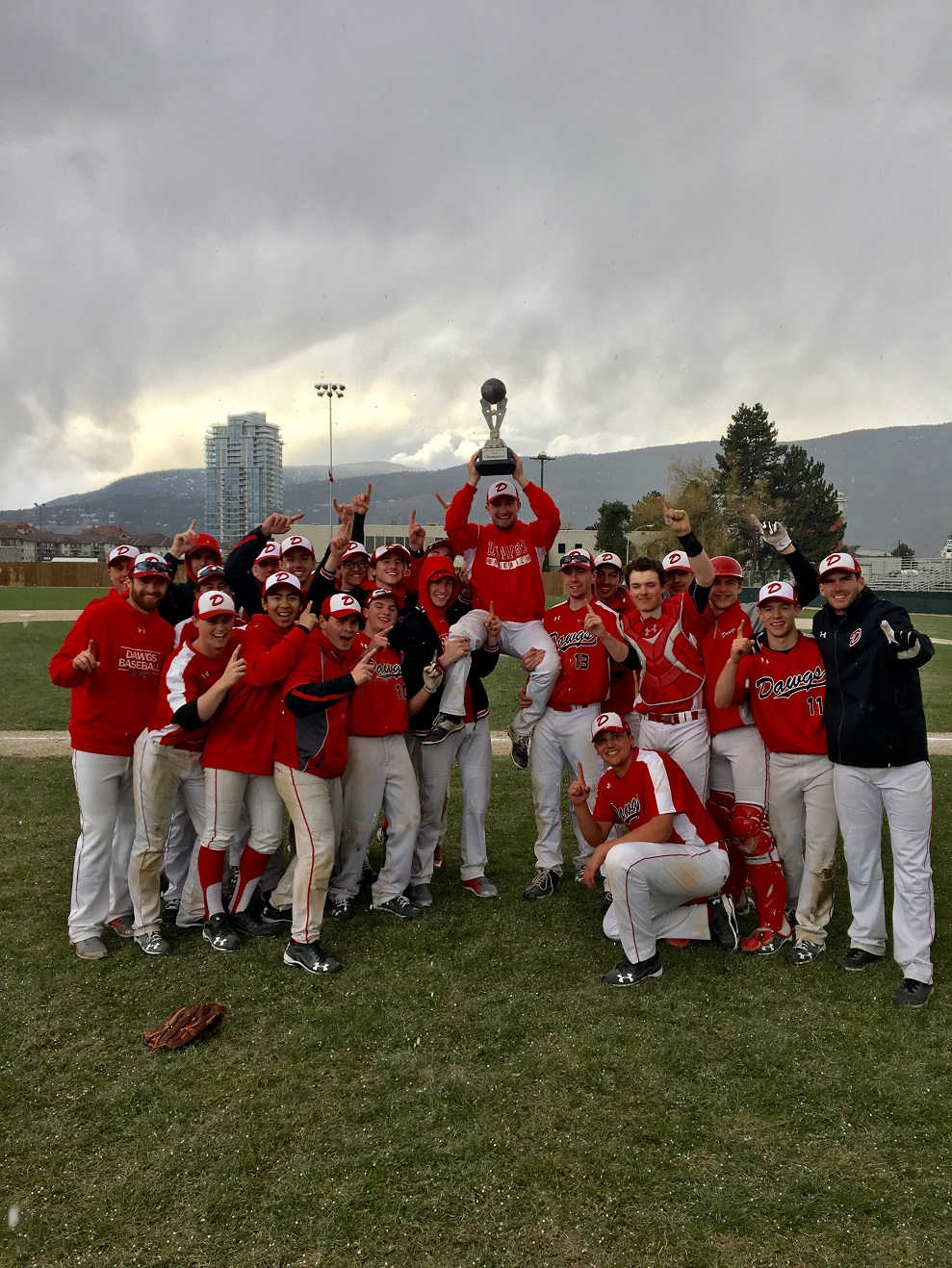 The Calgary Dawgs Red 18U celebrate after winning the Kelowna Invitational. That's spark plug Adam Little players are hoisting.