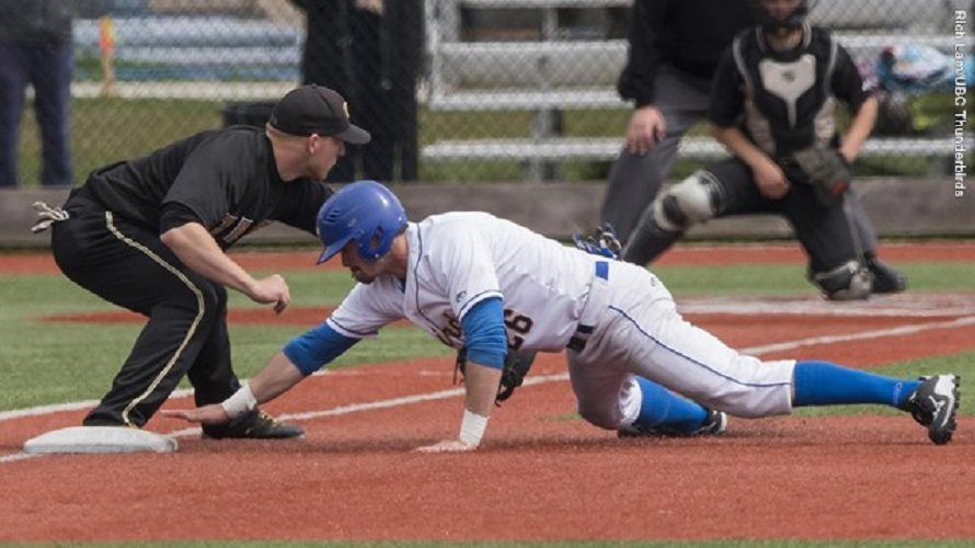 John Whaley dives back into first base.