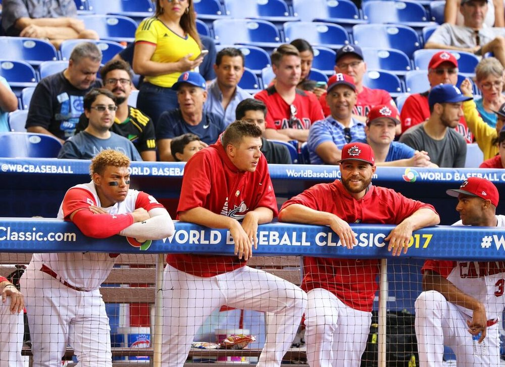Nick Pivetta, centre (Victoria, BC) gets some advice from Russell Martin (Montreal, Que.) right, during Pivetta's start against Colombia in the WBC, while Josh Nylor (Mississauga, Ont.) stands by. Photo: Amanada Fewer.