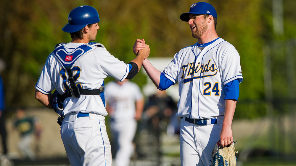 RHP Tyler Gillies (London, Ont.) shakes hands with his C Mackenzie Parlow (Qualicum Beach, BC) pitching a complete-game shut out to keep the UBC Thunderbirds season alive. Photo: Rich Lam.