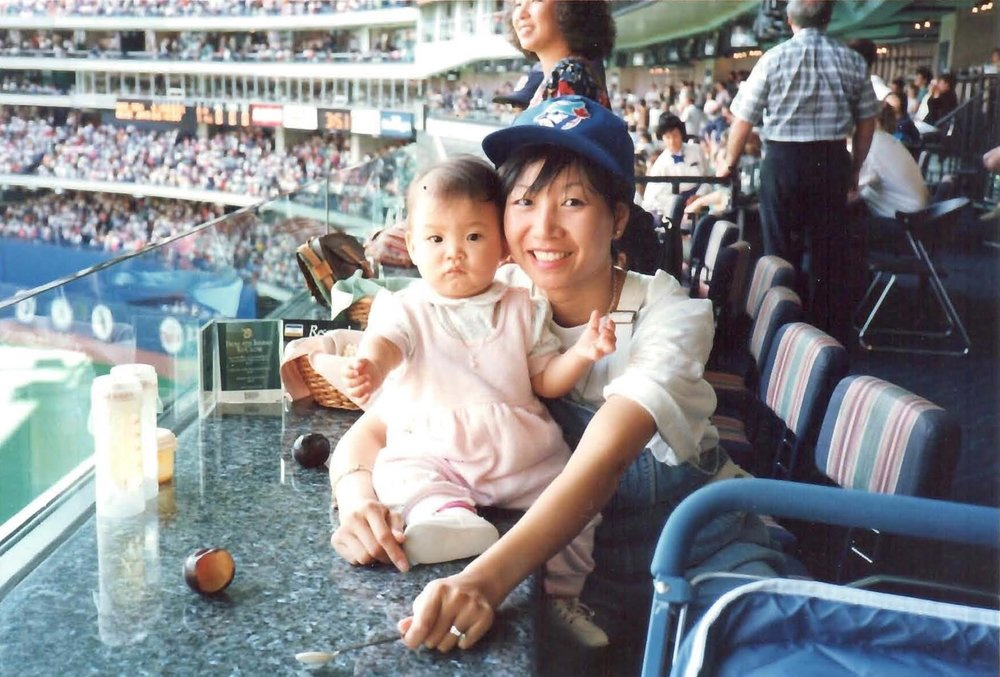 Jessica Ng was less than nine months old on her first trip to see the Blue Jays play -- shown here with Eva Ng sitting on a table at Windows restaurant.