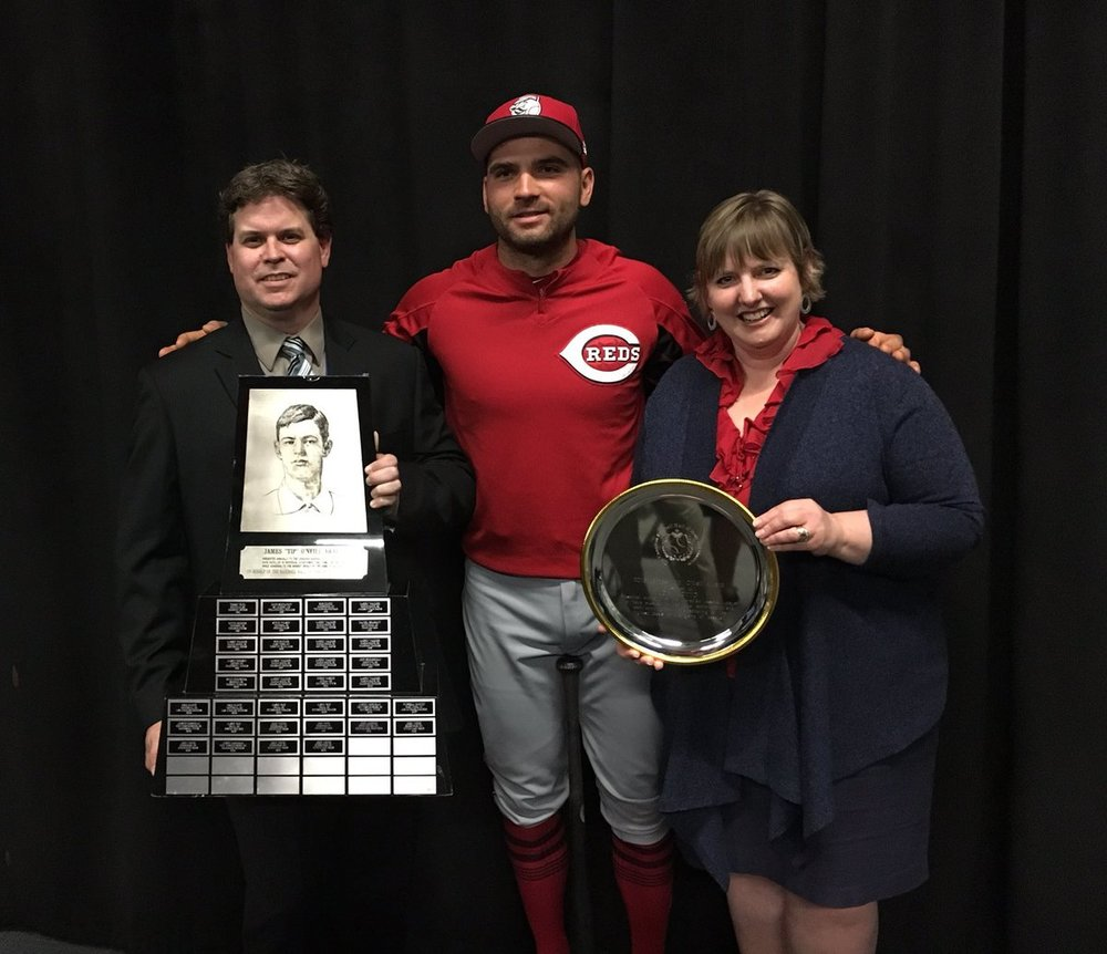Scott Crawford of the Canadian Baseball Hall of Fame and Tammy Adkin, Hall board member,  present Joey Votto (Etobicoke, Ont.) with the Tip O'Neill award, his sixth.