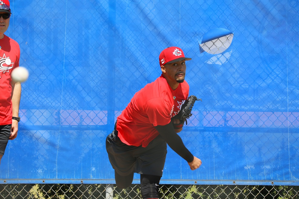 RP Jesen Therrien (Montreal, Que.) drafted by Phillies scout Alex Agostino (Montreal, Que.) throwing a bullpen during Team Canada workouts in Dunedin. He is 2-1 with a 1.26 ERa and seven saves with the double A Reading Fightin` Phils. Photo: Amanda Fewer.
