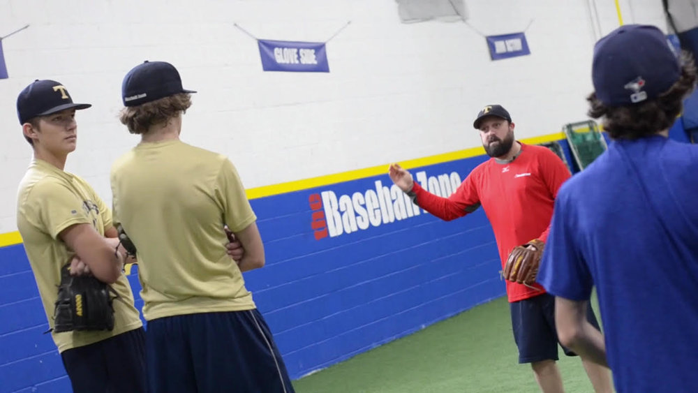 Ryan Armstrong explains pitching to three prospective Ontario Terriers.