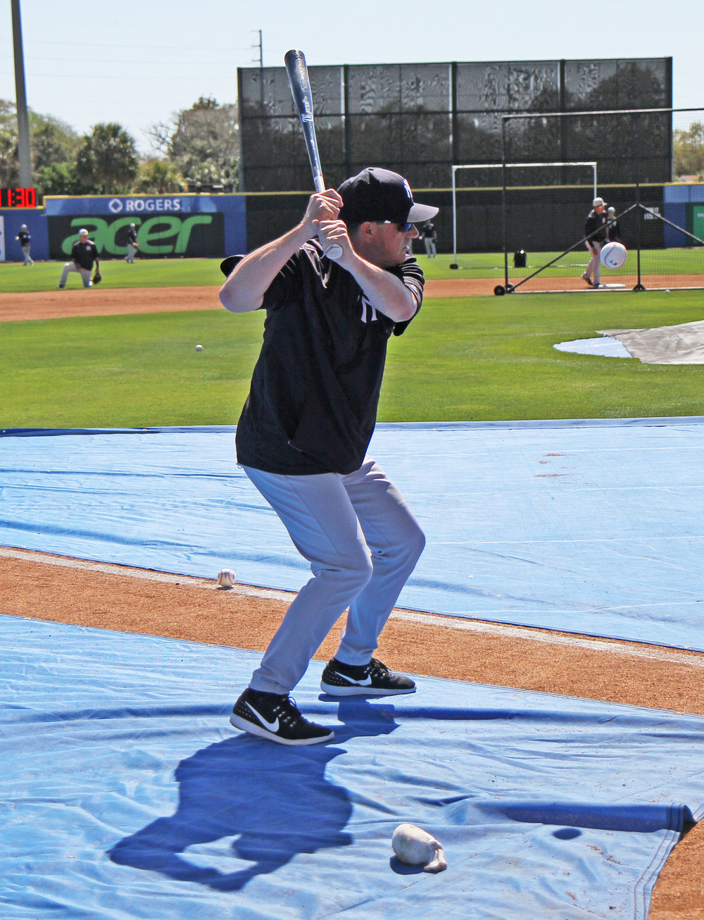 Prior to this spring training game in Dunedin, Fla., Thomson helped out by hitting grounders to Yankees infielders during batting practice. PHOTO: MATT ANTONACCI