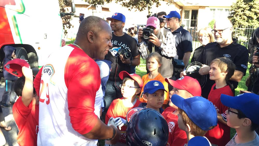 Xavier Nguyen (glasses) was there in Cardinal red to greet Joe Carter when he got off the bus.