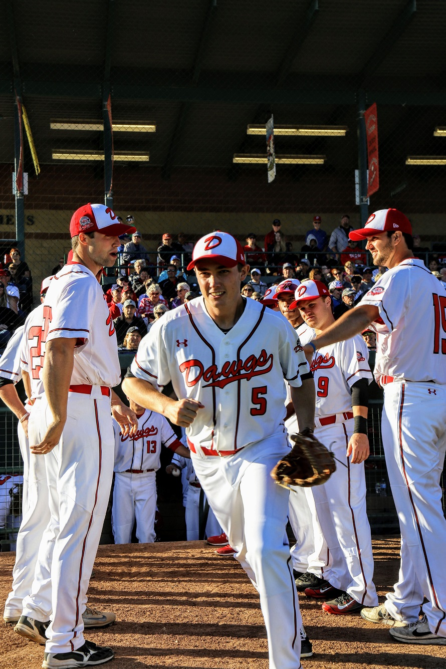 Brendn Rose runs the gauntet ... he had a pair of hits as the Okotoks Dawgs beat the Medicine Hat Mavericks 14-11.  Photos: Amanda Fewer