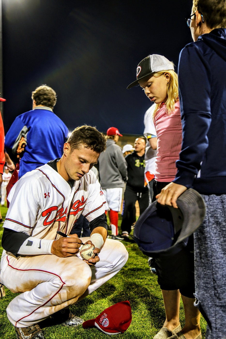 Peter Hutzal (Calgary, Alta.) signs a post-game autograph.