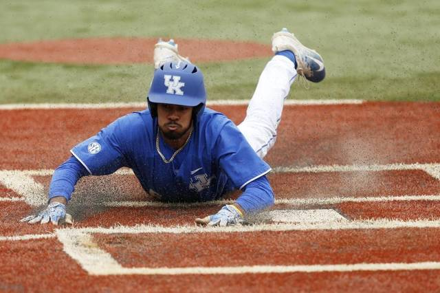 Arriving in a cloud of dust Kentucky OF Tristan Pompey. Photo: Michael Reaves Lexington Herald-Leader.