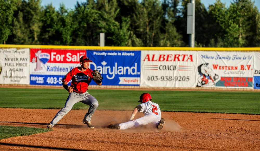 Okotoks Dawgs shortstop Peter Hutzal steals second base in the Dawgs' 14-7 loss to the Medicine Hat Mavericks on Friday. Photo Credit: Amanda Fewer