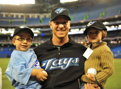 Roy Halladay, who will be inducted into the Canadian Baseball Hall of Fame on Saturday with two of his dear friends Issac McFadyen, left, and his younger brother Gabriel before a game at the Rogers Centre in 2008.