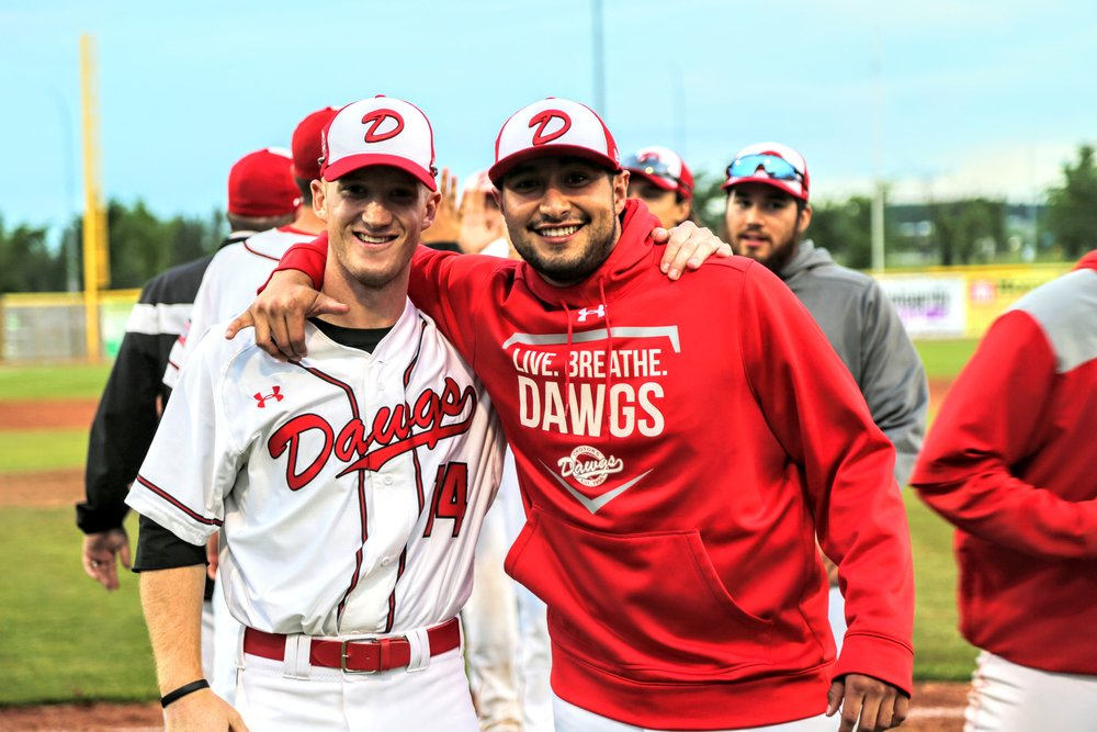 Joel Brophy and winning pitcher Anthony Balderas celebrate after the Okotoks Dawgs' third straight win on Monday. Photo Credit: Amanda Fewer