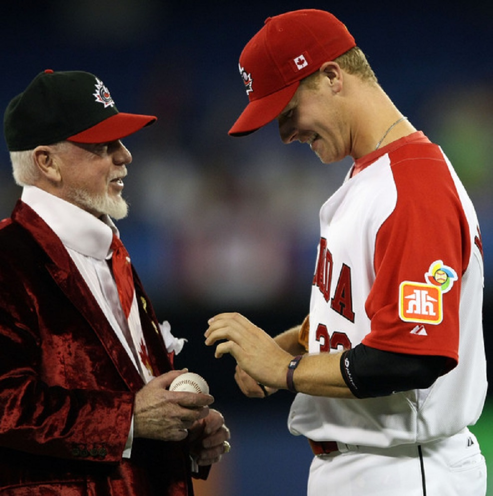 Don Cherry (Kingston, Ont. -- Canada's first capital) greets Justin Morneau (New Westminster, BC) before a 2009 WBC game at Rogers Centre.