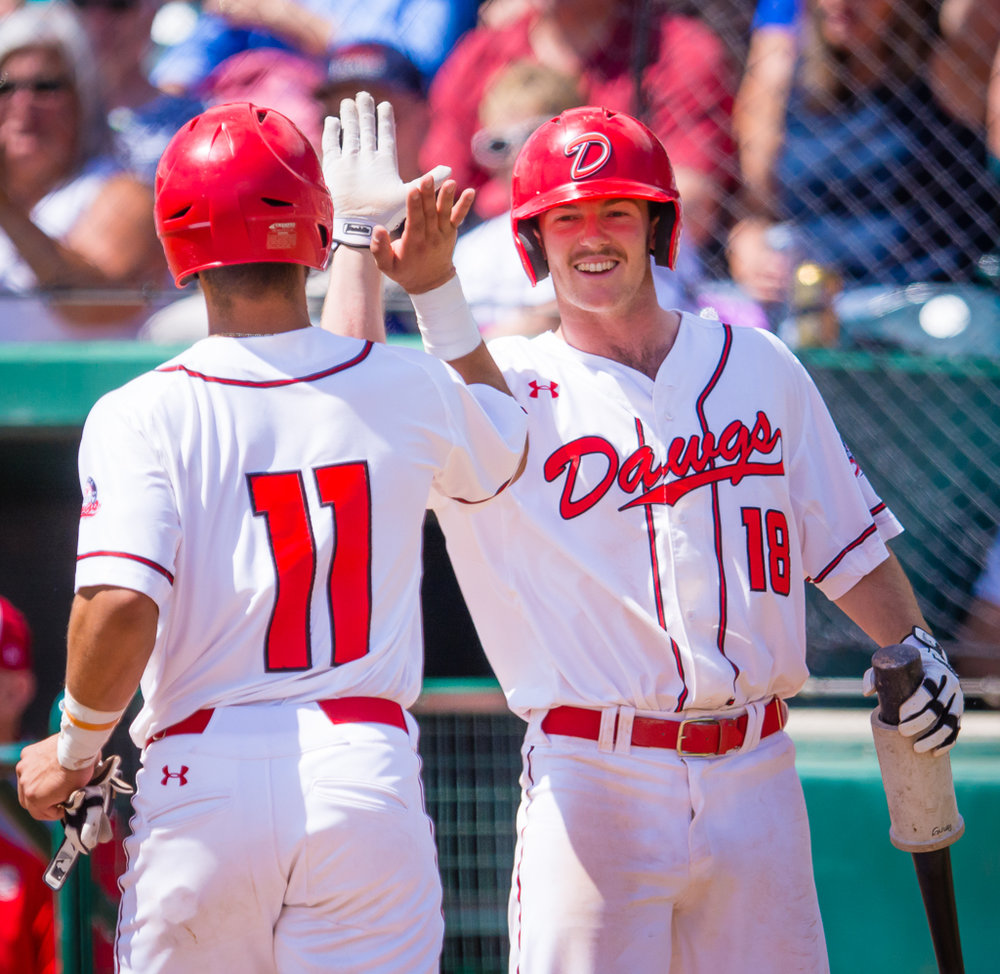 Greg Cullen (on right) delivered the game-winning walk-off hit for the Okotoks Dawgs on Wednesday. Photo Credit: Angela Burger