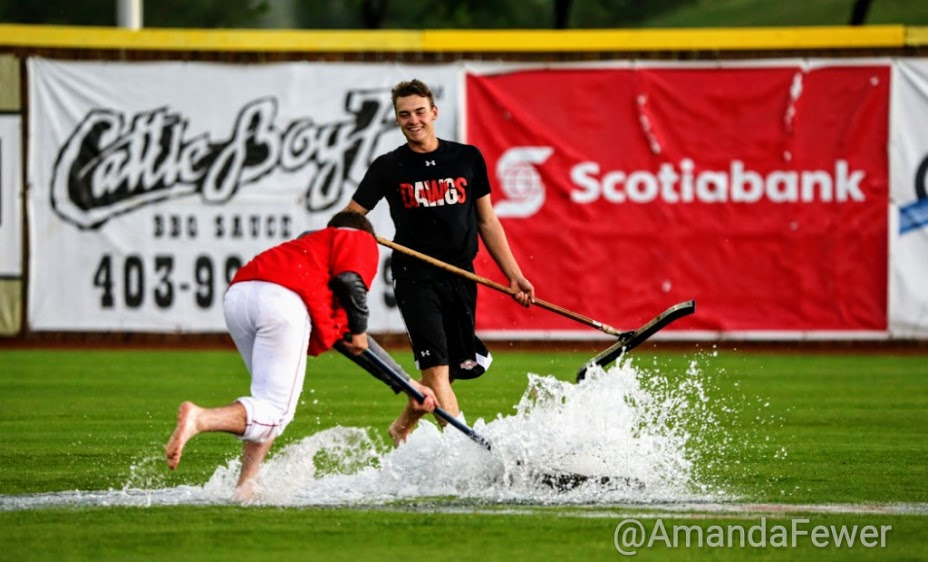 Everyone had to help prepare soaked Seaman Stadium, including Peter Hutzal.