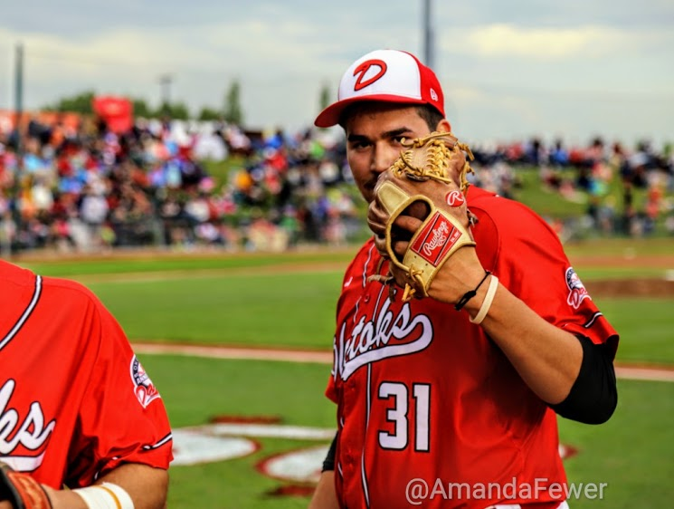 Who is that standing behind the glove? Why its Omar Celaya.
