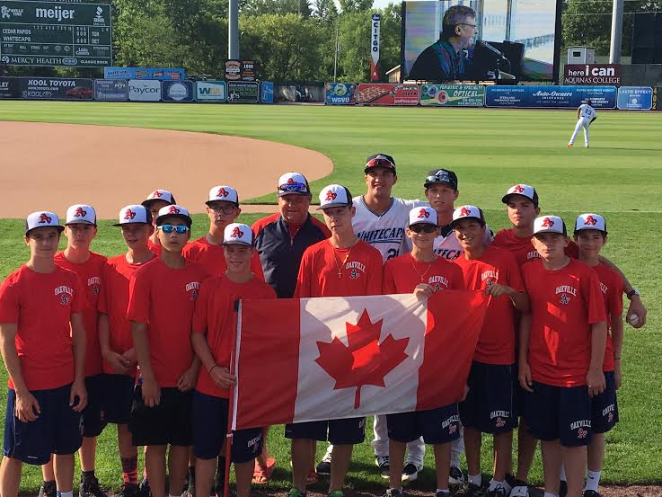 SS  Daniel Pinero (Toronto, Ont.) and OF Cole Bauml (Meunster, Sask.) -- back row in white -- of the class-A West Michigan Whitecaps, entertained coach Jeff Lamont's Oakville A's minor bantams in Grand Rapids, Mich.