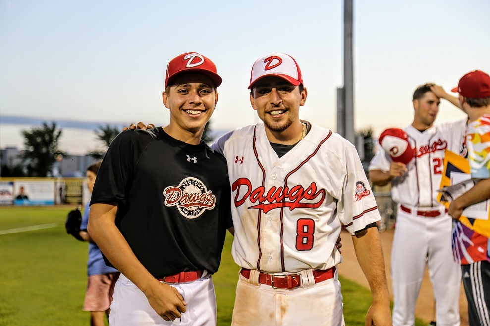 Eddie Sanchez (8) had a two-hit game and celebrated post-game with his brother Ricardo.