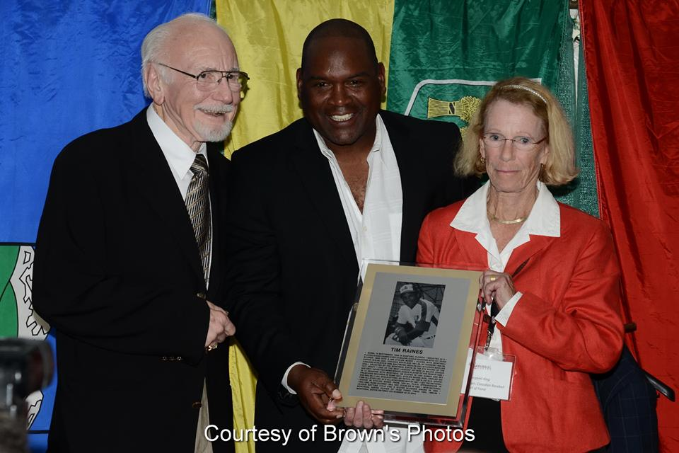 Tim Raines being presented with his plaque at his Canadian Baseball Hall of Fame induction ceremony in St. Marys, Ont., in 2014 by Jim Fanning (left) and Hall board chair Mike King (right). Photo Credit: Brown's Photos/Canadian Baseball Hall of Fame