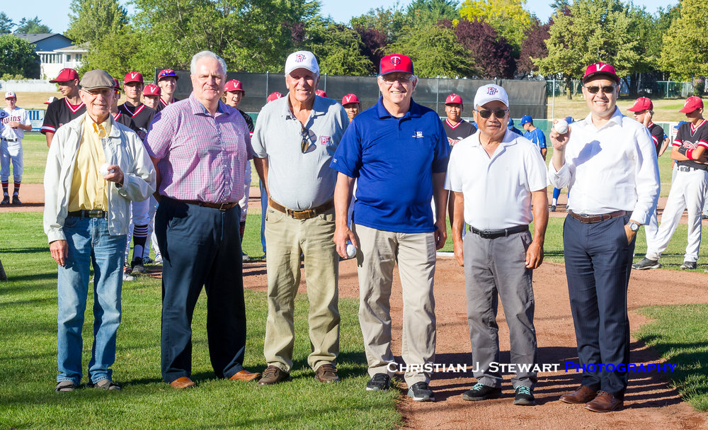 The founding members of the BC Premier Baseball League (from L to R) Lowell Hodges, Dave Wallace, Bill Green, Walt Burrows and Clyde Inouye) pose with Saanich Mayor Richard Atwell (right) after throwing out the ceremonial first pitch at the BC Junior Premier Provincials on Thursday (Photo: Christian J. Stewart / ISN)
