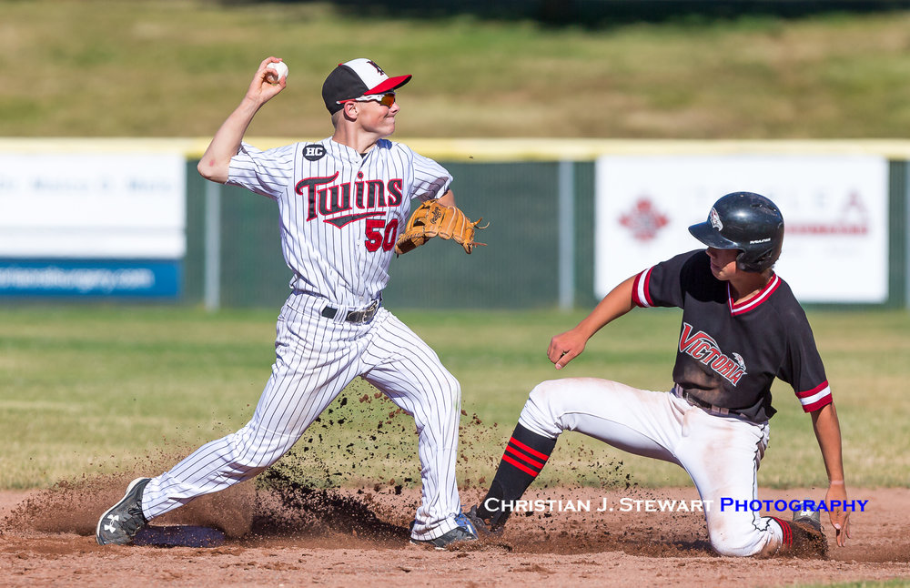 The Twins Matt Wiseman (50) attempts to turn a double play against the Eagles on Thursday (Photo: Christian J. Stewart / ISN)