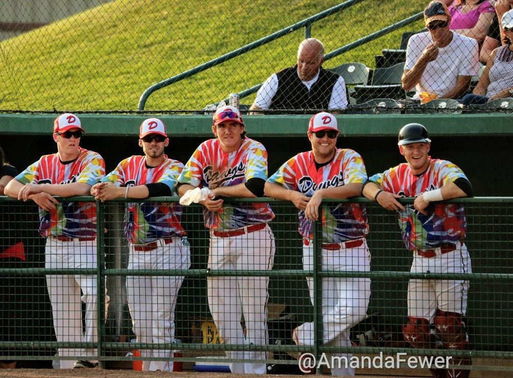 ... while in the dugout the Dawgs are a study of concentration and if we are not mistaken that appears to be the silver-tongued devil William Gardner working hard in the front row.  silver-tongued