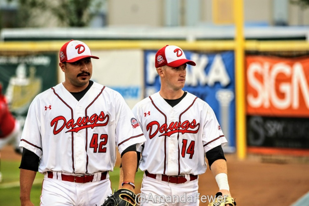 Anthony Balderas (42) and Joel Brophy (Burlington, Ont.) return to the Okotoks Dawgs dugout after finishing their bullpen session. Photos: Amanda Fewer.