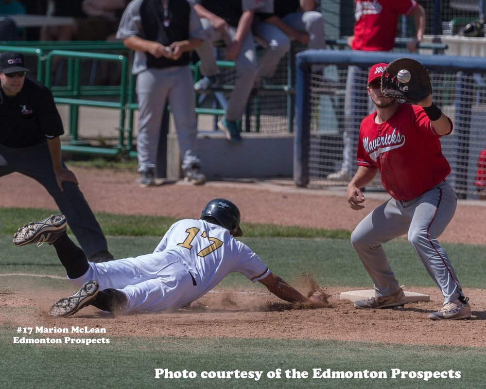 Marion McLean of the Edmonton Prospects dives back into first base in Tuesday's game against the Medicine Hat Mavericks. The Prospects won 9-0. Photo Credit: Edmonton Prospects