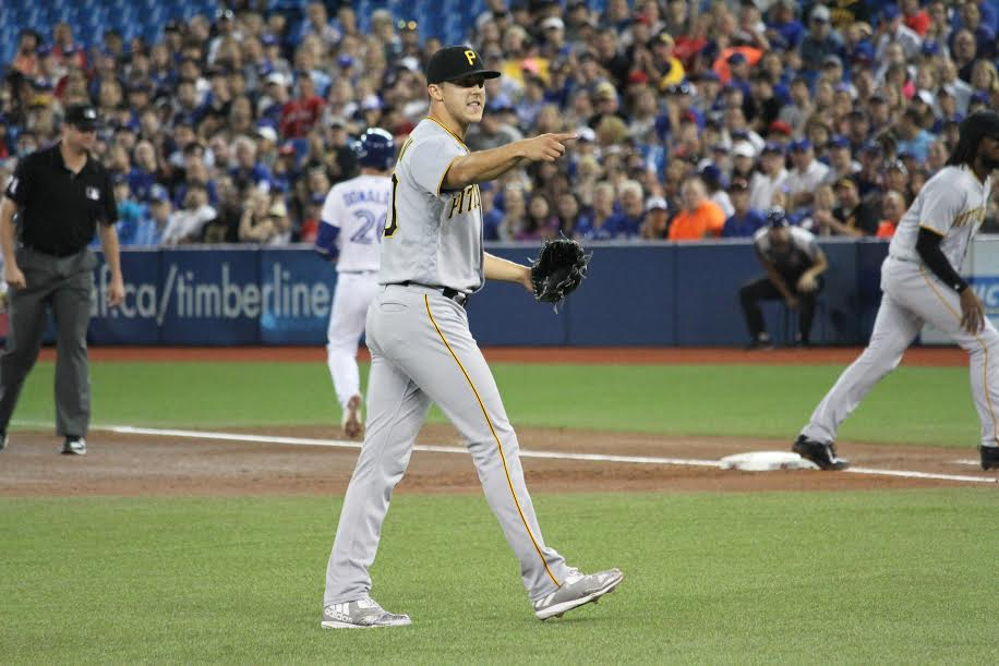 TAILLON GESTURES TO HIS TEAMMATES AFTER HIS DEFENSIVE PICKED HIM UP TO END THE INNING.