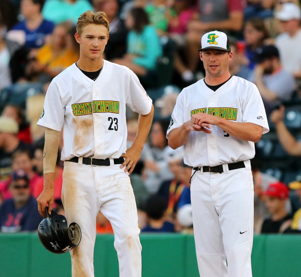 Logan Fritzke (left) on base in the gold medal game, next to Brennan Peterson - former Swift Current Indian and former coach of the midget minor ball team (photo courtesy of Darryl Gershman)