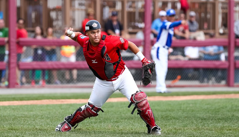 Catcher Archer Brookman (Pointe-Claire, Que.) prepares to throw a ball to first base in Canada's 11-7 loss to South Korea at the U18 World Baseball Cup in Thunder Bay, Ont., on Sunday. Photo Credit: WBSC/Christian Stewart