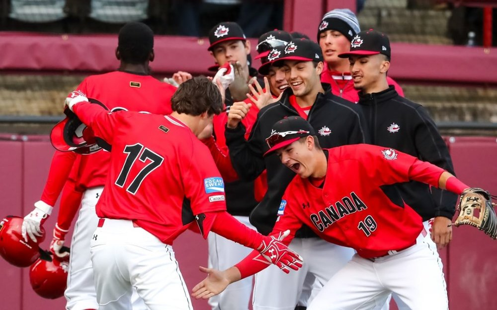 Team Canada celebrates Edouard Julien's three-run home run in the second inning in their 8-2 win over Australia on Tuesday.  Photo Credit: WBSC/Christian Stewart