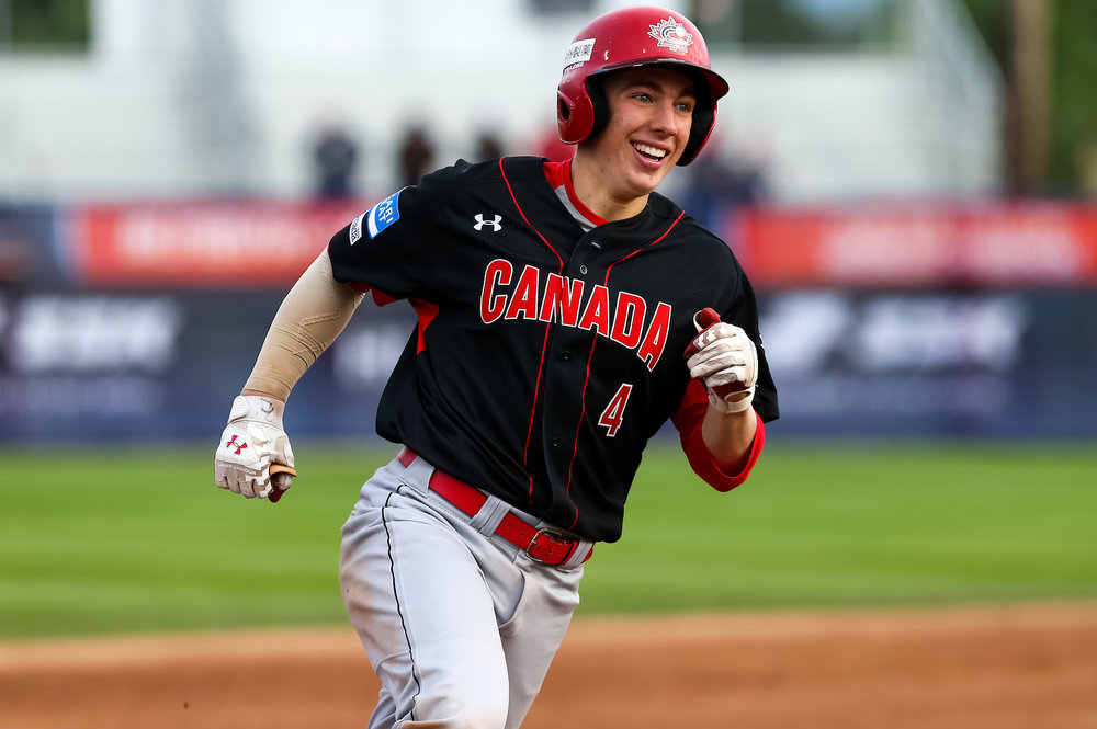 Victor Cerny (Winnipeg Man.) went 3-for-5 including a three-run homer as Canada thumped Nicaaragua 15-3 to advance to the Super Round in Thunder Bay. Photo:Christian J. Stewart.