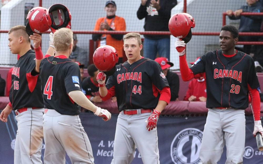 Winnipeg native Victor Cerny (second from left) celebrates his home run in Canada's 15-3 rout of Nicaragua at the U18 Baseball World Cup on Wednesday with teammates (left to right) Archer Brookman (Pointe-Claire, Que.), Michael Stovman (Maple Ridge, B.C.) and Denzel Clarke (Pickering, Ont.). Photo Credit: WBSC/Christian Stewart