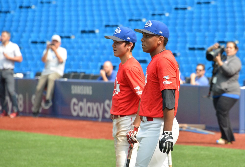 LaRon Smith (right) looks on after finishing his session of batting practice at Rogers Centre for Tournament 12. Photo Credit: Yoram Kerbel/Toronto Observer