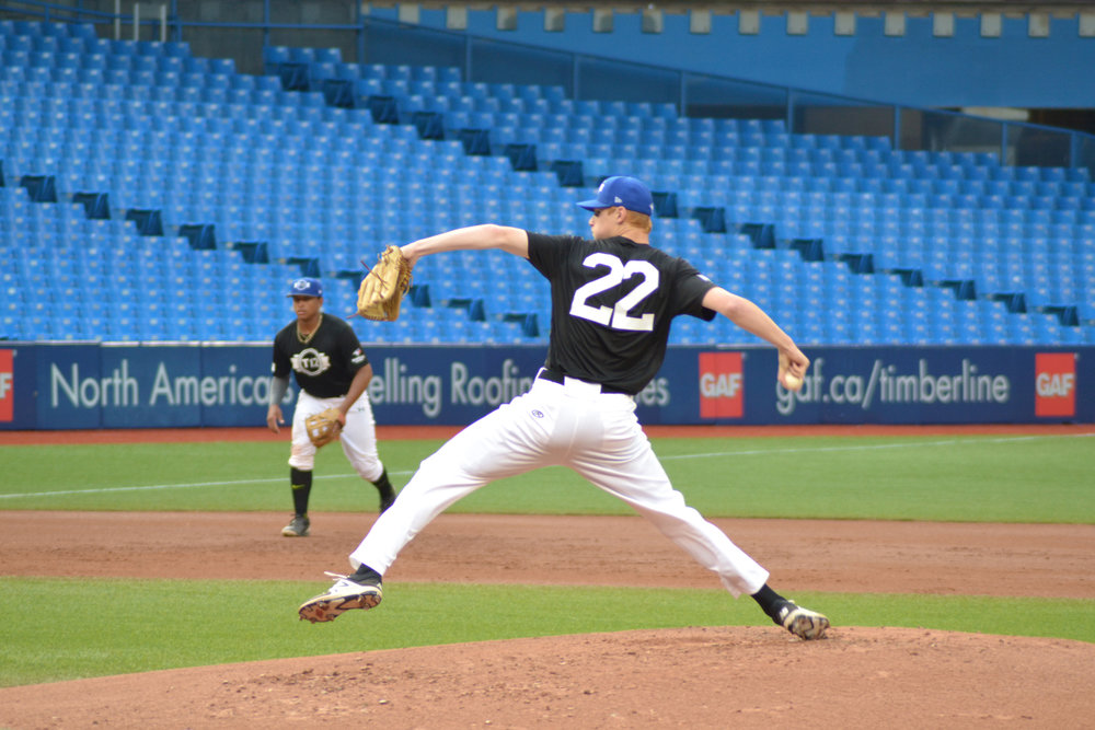 Eric Cerantola pitches on the mound for Ontario Black Friday night at Rogers Centre in round-robin play of Tournament 12. Photo Credit: Jas Grewal